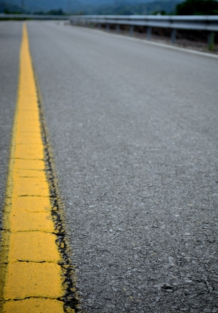 Cracked yellow line on the straight road