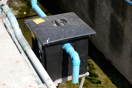 Outdoor grease trap tank, outside a restaurant
