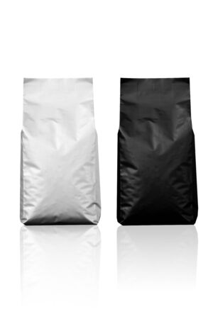 White and Black Foil Bags Isolated on white background Stock Photo