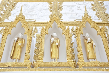 This is molding of monk on wall of stupa in north east thailand photo