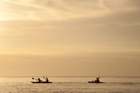 Enjoy canoeing in the beautiful beach of Thailand sea photo