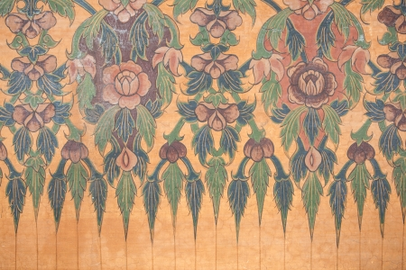 Lotus flower in traditional thai style art on wall of the temple photo