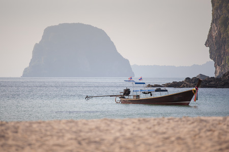 The long-tail boat, known as Ruea Hang Yao during sunset time. photo