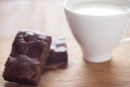 chewy: Chewy Fudgy chocolate chip Homemade Brownies with hot milk Stock Photo