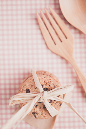 Chocolate chip with bow tie on tablecloths photo