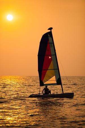 Beatuiful sunset sailing boat photo