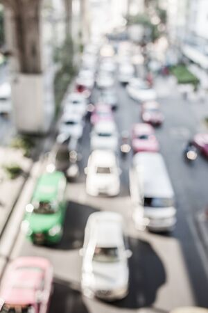 saturation: Blurred traffic jam background with low color saturation