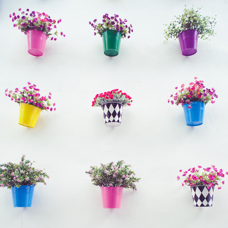 flower pot: Beautiful hanging flower pots on the wall