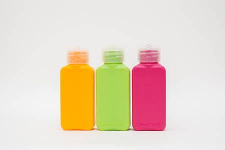 The square plastic bottles with a cover is isolated on a white background Stock Photo