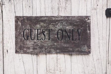 style advice: Ancient guest only sign on the wooden door