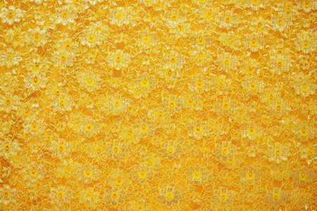 gold lace: Gold lace sits on a gold silk background