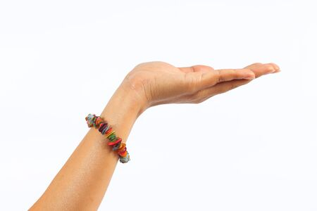 left hand: left hand woman showing for grabs and bracelet on white background Stock Photo