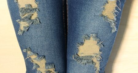 torn jeans: Fashionable Lady Style. Torn Jeans Stock Photo