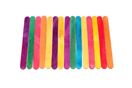 helados con palito: Colorful wood ice cream stick on white background