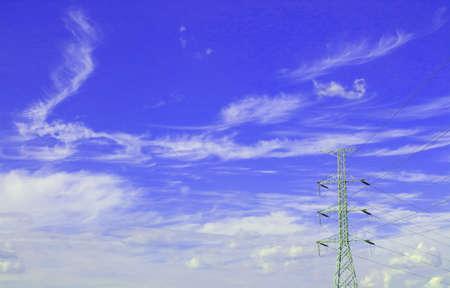 color distribution: power poles against cloudy sky