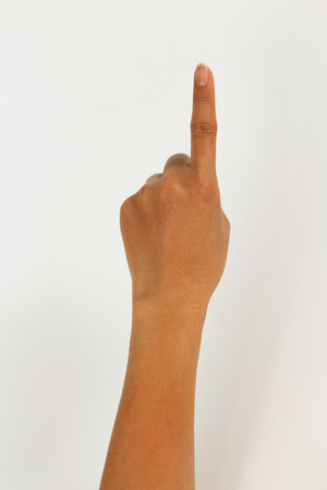 one finger: women hand isolated on white background showing one finger Stock Photo