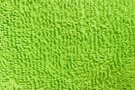 Background texture of green or yellow carpet