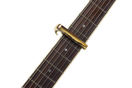 Electric guitar neck with a capo isolated on white background.