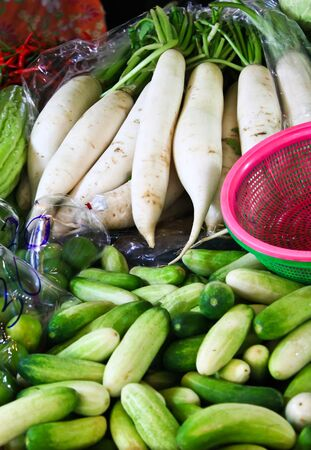 The Radishes and cucumbers in fresh-food market photo