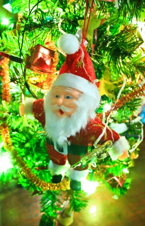 Santa claus doll hang on the christmas tree photo