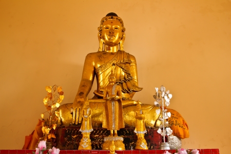 Buddha image made from teakwood  in Srichum temple Stock Photo