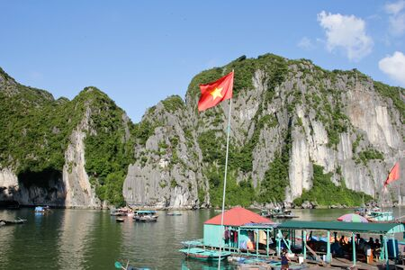 long bay: Vietnam flag at Ha long bay Stock Photo