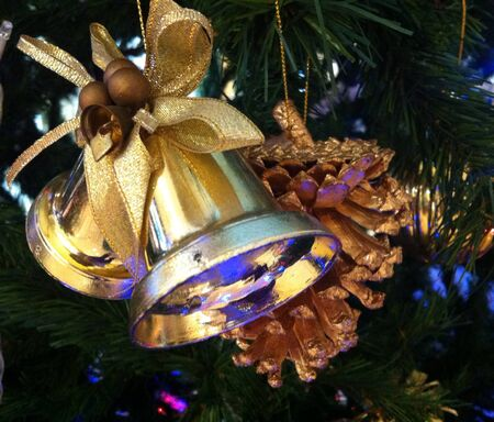decorate: Decorate christmas tree with golden bell
