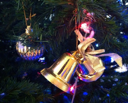 newyear: Decorate christmas tree with golden bell and ball