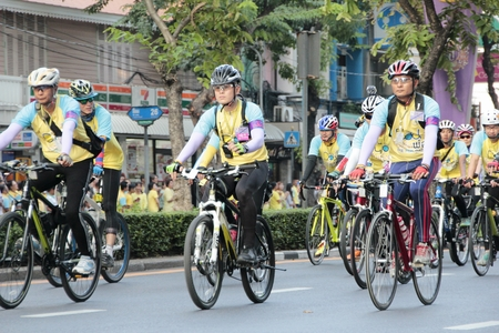 silom: SILOM, BANGKOK- DECEMBER 11,2015 : Thai people and foreign ride bicycle in Bike for dad activity for honor thai king Editorial