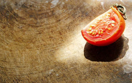 dissect: Dissect tomato on wooden background