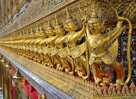 Golden garuda decorated on the wall of Thai ancient traditional temple  Stock Photo