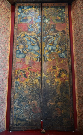 Thai antique painting of Thai classical story on the door  Stock Photo