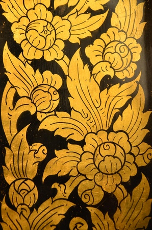 Close up of Thai painting in golden color  Show traditional luxurious style of Thailand
