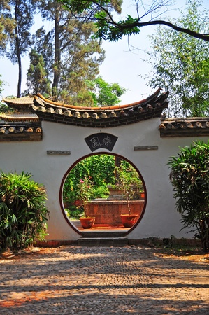 dazzlingly: Chinese ancient traditional arch door in the garden