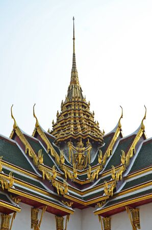dazzlingly: Thai gable and roof with traditional luxurious decoration with garuda  Stock Photo