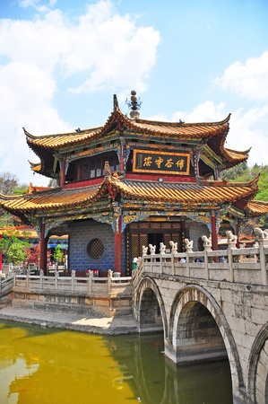 Chinese traditional architecture of temple on the pond with the stone bridge  Stock Photo