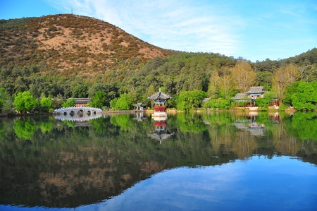 Landscape of beautiful lake with mountain background and Chinese traditional building