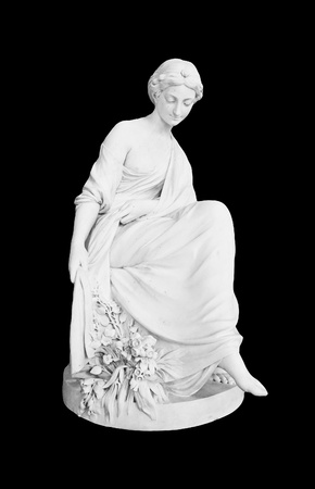 Photo of lady sculpture isolated on the black background