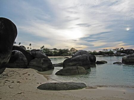 Landscape of the beach and big rock with the evening mood              Stock Photo