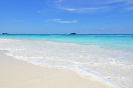 A very clear beach with white sand and blue sea