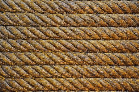 Close up of the row of big brown rope