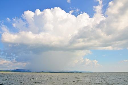 Landscape of overcast cloud raining on the island  Stock Photo