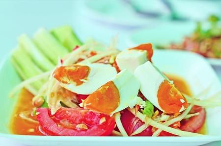 Close up of Thai style papaya salad with salted egg  Stock Photo