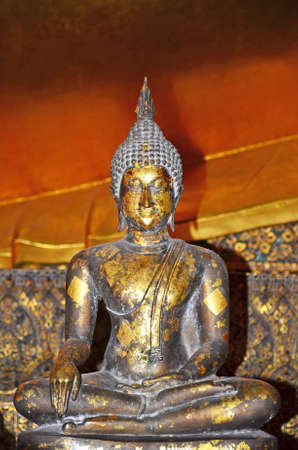 Close up of small beautiful ancient buddha in old temple