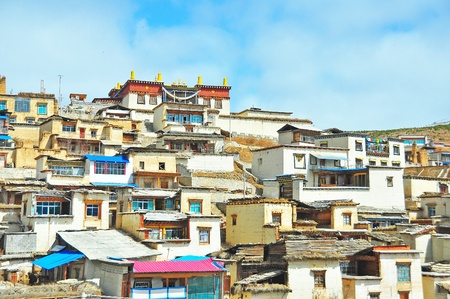 Landscape of Tibetan traditional houses and Tibetan temple on the top of village  Stock Photo - 13718184
