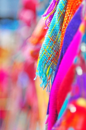 Focus of blue knitting wool with colorful background