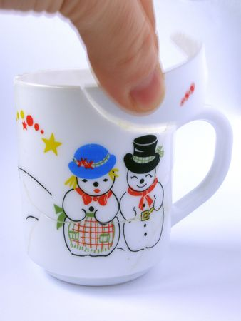Mending up broken cup with Christmas motive