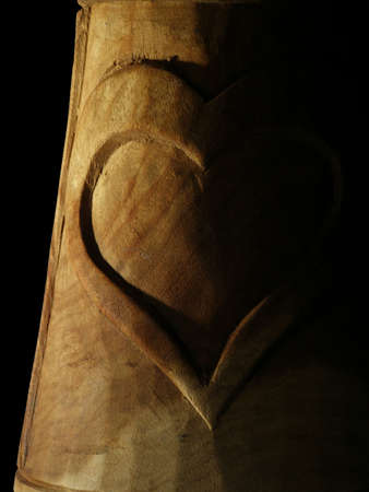 bas relief: bas relief of heart on black Stock Photo