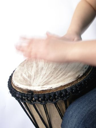 playing african handdrum