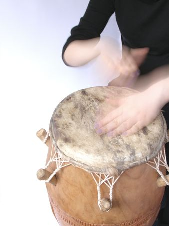 playing African kpalogo drum        photo